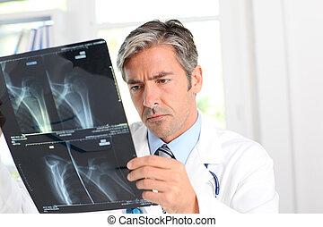 Man looking at Xray results
