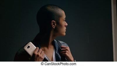 Young man looking away in corridor 4k