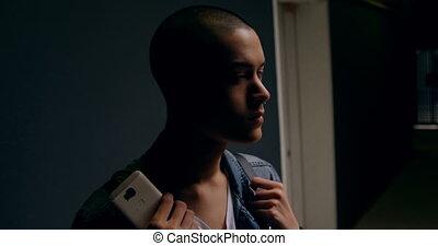 Man looking away in corridor 4k - Young man looking away in ...