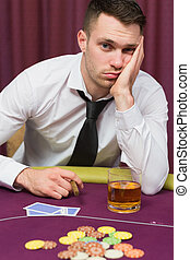 Man looking depressed at poker table