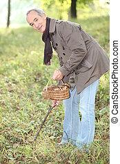 Man looking for wild mushrooms