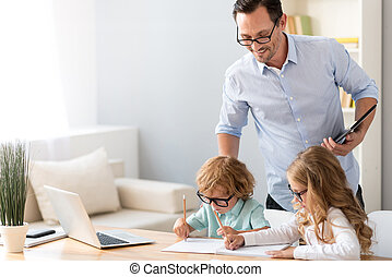 Man looking how children drawing