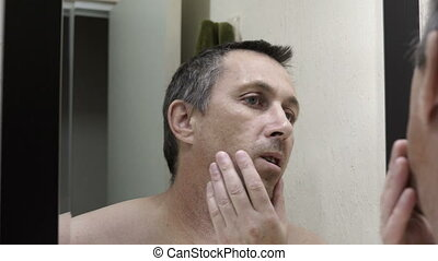 Man Looking in Mirror at His Gray Hair - Close up over the ...