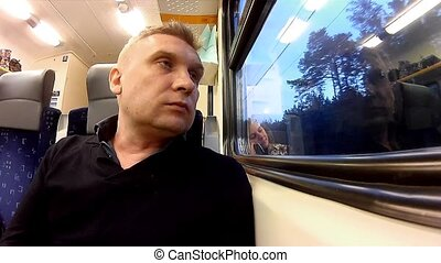 man looking in the window of the train