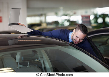 Man looking inside the car