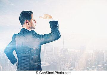 Man looking into the distance multiexposure