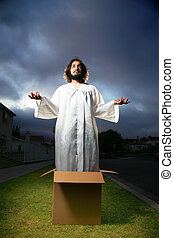 Man looking like Jesus standing in the box with hands raised.