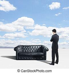 man looking on sofa
