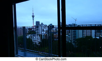 Man looking out balcony Auckland