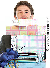 Man looking out from stack of gift boxes
