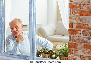 Man looking out the window