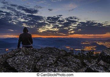 Man looking the sunrise