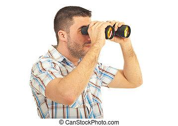 Man looking through binocular