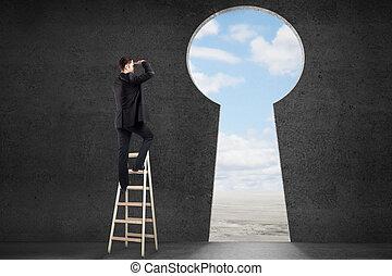 Man looking through keyhole