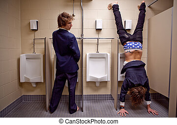 Man looking to an other man in a restroom doing werid things...