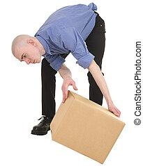 Man looking under cardboard box