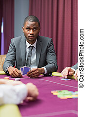 Man looking up from poker