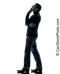 man looking up pensive silhouette full length