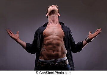 man looking up with his arms open
