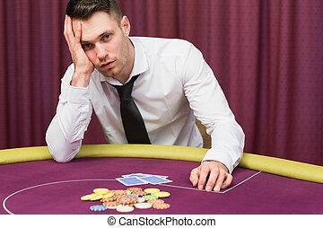 Man looking worried at poker table