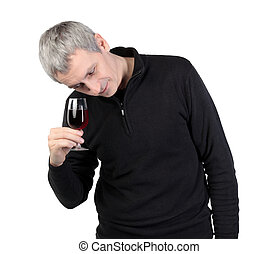 Man looks at a glass of red port wine, on white background