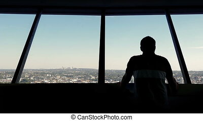 Man Looks At City From Observation Deck - Man walks over and...