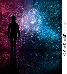 man looks at the cosmos