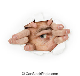 Man looks through a hole in paper