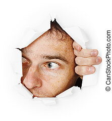 Man looks through hole - The man startled looks through a...