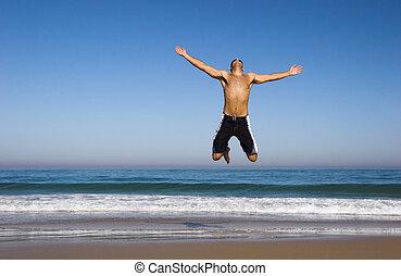 man lopend, en, springt, op het strand