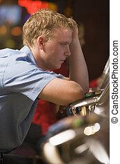 Man losing at slot machines