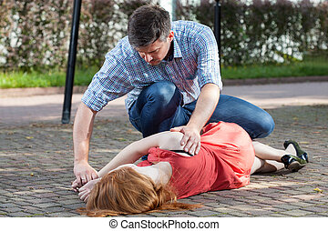 Man lying girl in recovery position - Man lying unconscious...