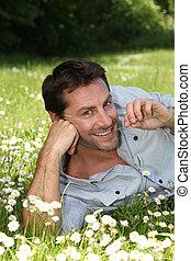 Man lying in a meadow