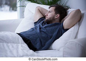 Man lying in bed - Image of thinking man lying in bed