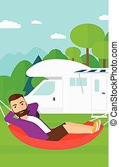 Man lying in hammock.
