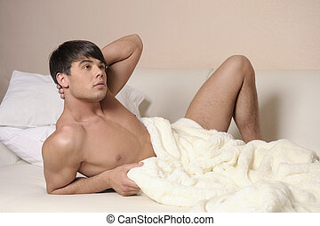 Man lying on a bed.