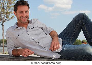 man lying on a bench