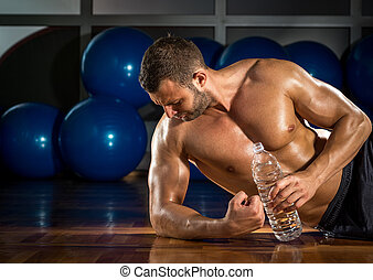 Man lying on gym floor