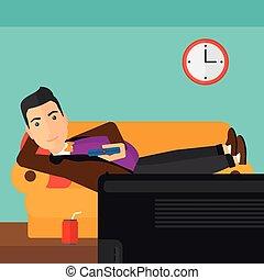 Man lying on sofa. - A man lying on a sofa and watching tv...
