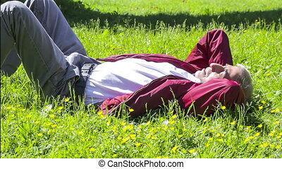 Man lying on the grass on a sunny d