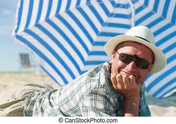 man lying sand summer beach happy smile