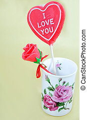 Man-made candy rose in vase