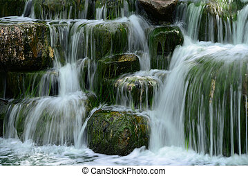 Man made waterfall or cascade with silky water