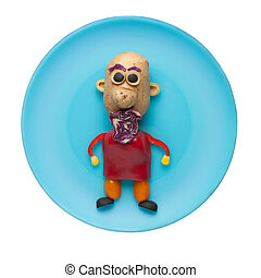 Man made of fresh vegetables on blue plate