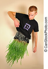 Man made of Grass - Young attractive man lifting up his...