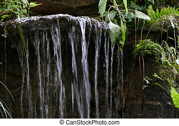man made waterfall in the garden