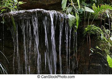 man made waterfall in the garden