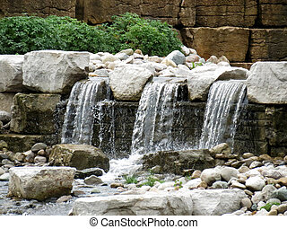 Man-Made Waterfall - A small waterfall feature cascading on...