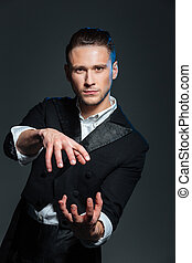 Man magician showing tricks
