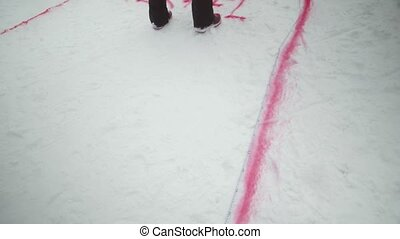Man make red spray marking on snowboarding trail. Snowy mountain. Ski resort. Challenge. Competition